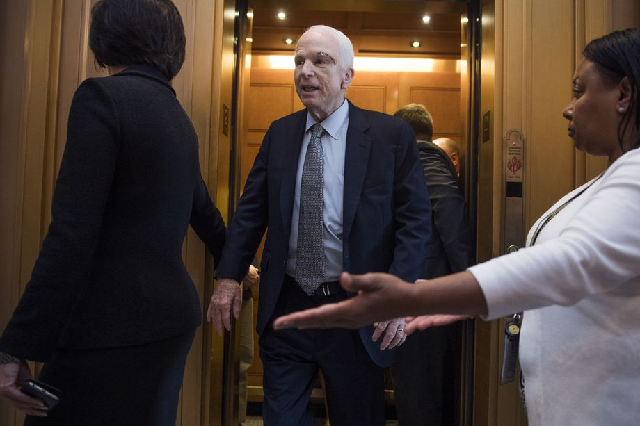 John McCain walks onto the Senate floor Tom Williams CQ Roll Call Getty.jpg